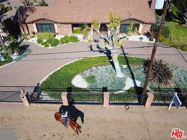 Every street in Norco, CA is set up for horses, like this trail that runs in front of this house for sale in Norco