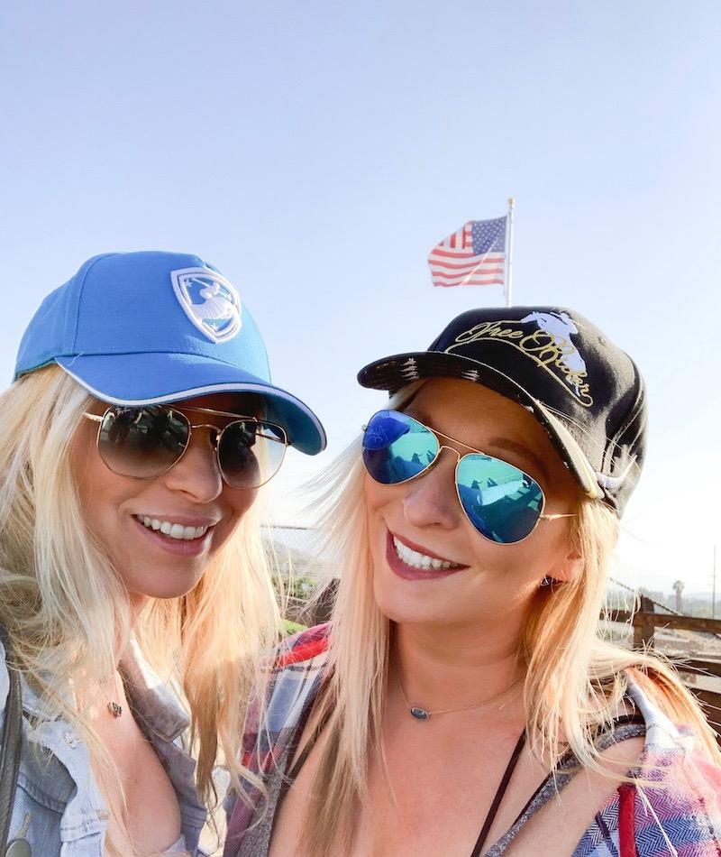 Alycia Burton free riding tour merchandise - sisters wearing Alycia Burton hat