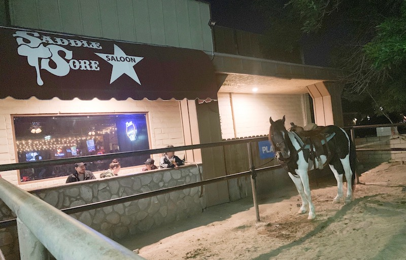 Alycia burton free riding tour in Norco, horse tied up in front of Saddle Sore Saloon in Norco